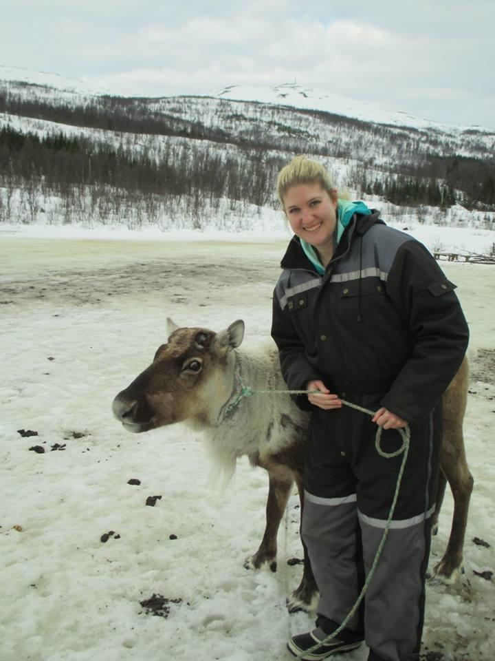 Kelly in Norway with a reindeer